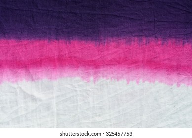 pink tone tie dye pattern dip dyed technique on cotton fabric background.