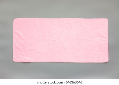 Pink towel on a gray background