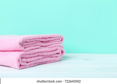 Pink towels on a green background