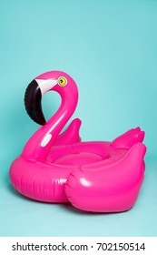 Pink, trendy, blown beach flamingo on a blue background. Hit the summer