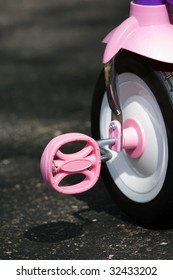 pink tricycle pedal