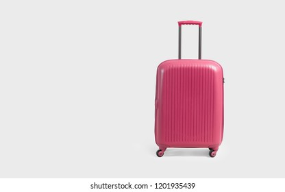 Pink trolley suitcase isolated on white