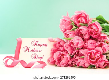 Pink tulips and greeting card with sample text Happy Mothers Day!