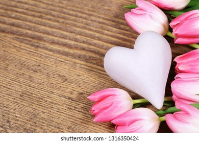 Pink tulips with heart, copy space