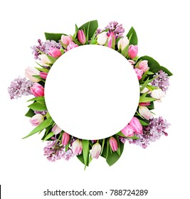Pink tulips and lilac flowers in round frame with white circle for text isolated on white background