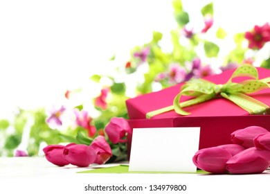 Pink tulips,blank card and gift box on white background