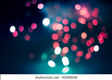 Pink and turquoise lights in the night, firework