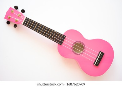 Pink Ukulele Four String Guitar - Top View Musical Instrument Isolated on White Background