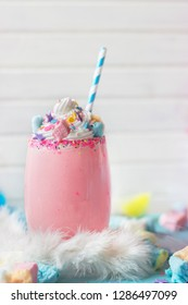 Pink Unicorn strawberry milkshake with  whipped cream, sugar and colorful confetti