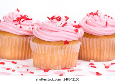 Pink Valentines Day cupcakes with sprinkles, shallow depth of field