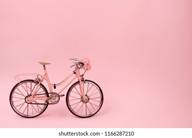 Pink vintage bicycle on pink background. pastel minimal style concept.