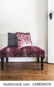 Pink vintage ottoman with cute cushions