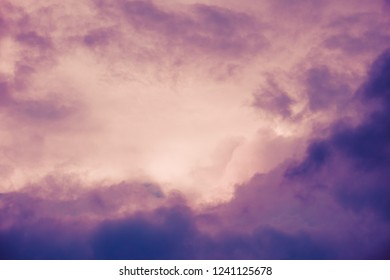 Pink and violet, dark dramatic clouds in sky. Copy space. For background and wallpaper