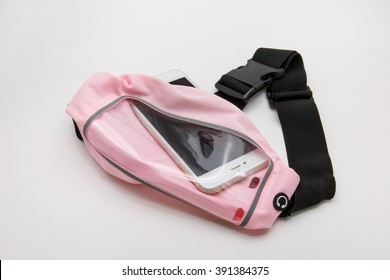 Pink waist bag with smart phone inside on white background