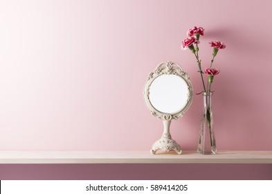 pink wall and shelf