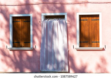 Pink wall with window and door, Burano
