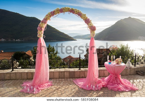 Pink wedding arch and decoration table at Adriatic bay