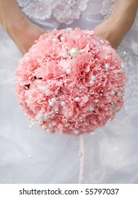 pink wedding bouquet at bride's hands