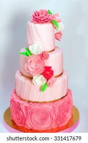 Pink wedding cake isolated on white background. Handmade Wedding Cake.