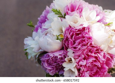 Pink wedding peonny flowers with fresia brunch
