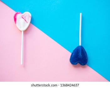 Pink and white and blue lollipops on a pink and blue background