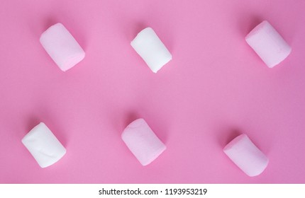 Pink and white marshmallow on light trendy pastel colors background. Advertising and banner template.