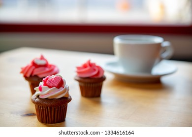 pink and white muffins  with coffee cup