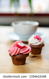 pink and white muffins  with cup of tea