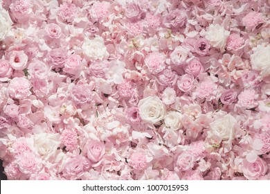 The pink and white roses floristry art backdrop background. The love in valentine event concept.