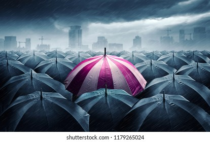 Pink and white umbrella with dark stormy clouds. Concept for success.