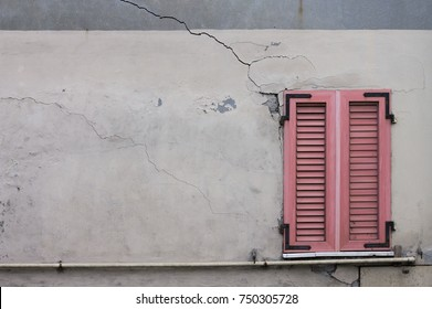 Pink window of a ruined house (Pesaro, Italy)