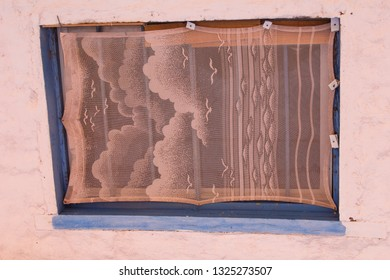 Pink Windowshade framed in blue on a pink wall