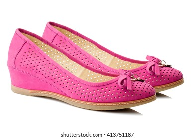 Pink women boat shoes isolated on white background.
