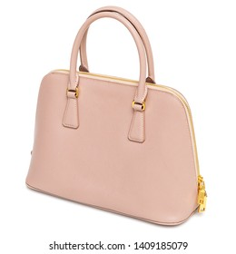 Pink womens' leather handbag isolated on a white background