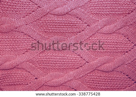 f3429543e7c27 Pink wool sweater texture close up. Knitted jersey background with a relief  pattern