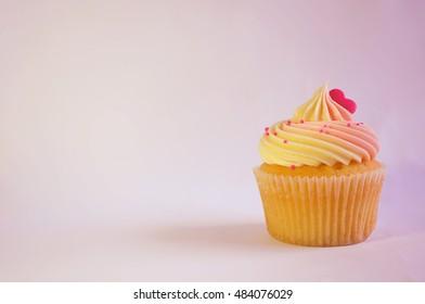 Pink and yellow cupcake