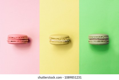 Pink, Yellow and green Macaron on same color background