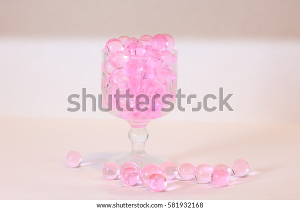 Pinkish aroma beads in a glass