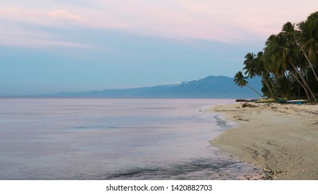 Pinkish hue on the sky and sea at dusk in a philippine island of talikud davao