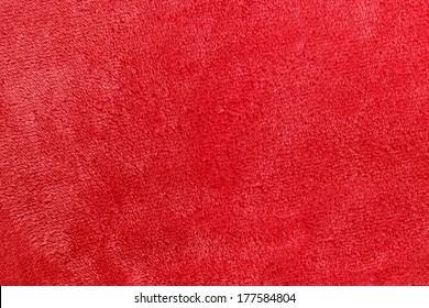 a pinkish red background of warm, cozy micro-fleece blanket fabric