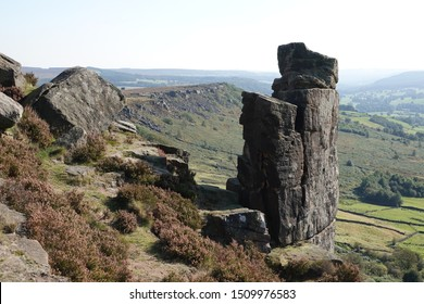 The pinnacle. A tower of millstone grit that stands high above Curbar Edge, a millstone grit outcrop above the village of Curbar in The Derbyshire Dales, Engand.