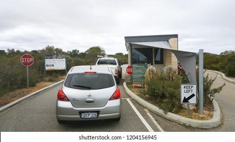 Pinnacles, Australia - September 2, 2017: Cars queuing at the ticket counter to enter the Nambung National Park, the Pinnacles desert.