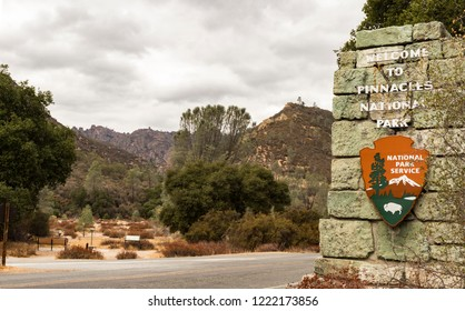 Pinnacles National Park, Pacines, California, USA - October 11, 2018: Entrance with NPS sign and a view of High Peaks at Pinnacles National Park, California, USA.