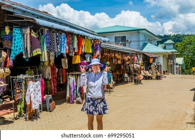 Pinnawala, Sri Lanka, May 12th, 2017, A young female Chinese tourist  at the shops of Sri Lankan traditional handcrafted goods for sale in Pinnawala Elephant Orphanage in Rambukkana, Sri Lanka