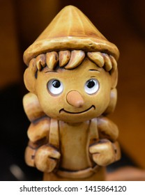 Pinocchio with a backpack, funny Pinocchio, happy Pinocchio, wooden toy