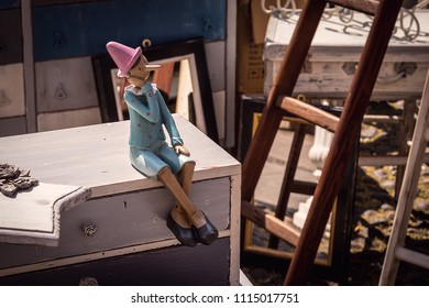 Pinocchio statuette sitting and smiling