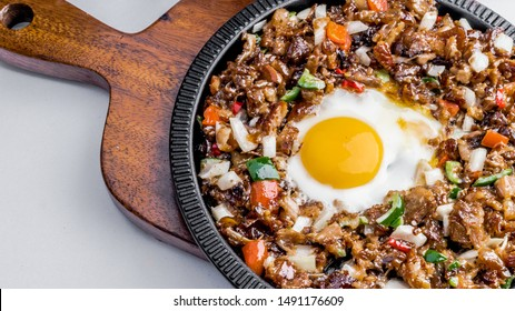 Pinoy Sizzling Sisig with Egg