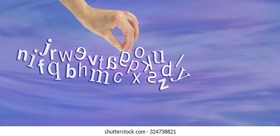 Pinpointing Dyslexia Website Banner -  female hand picking out a reversed G from a jumble of alphabet letters flowing across the  page symbolizing dyslexia