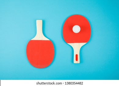 Pin-pong rubbers and a ball on close up. Sport concept