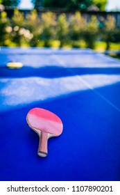 Pin-pong rubbers on blue playing board
